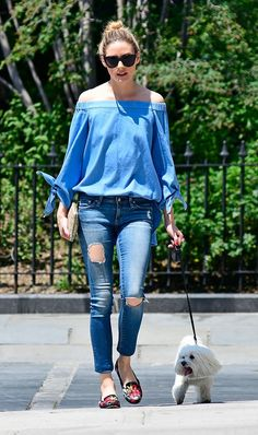Olivia Palermo enjoys a sunny walk with her dog in the top of the summer, an off the shoulder top, paired with jeans and embroidered loafers