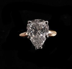 Designed in 14kt yellow gold, this pear shape  diamond weighs 1.08 carats. The setting has a smooth shiny finish.