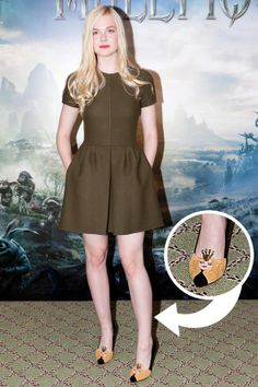 """""""Maleficent"""" World Press Tour - """"Maleficent"""" World Press Tour Elle Fanning arrived to the 'Maleficent' Paris Photocall wearing a pair of Charlotte Olympia """"Sleeping Beauty"""" shoes as a nod to the character she plays in the film."""