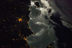 Archive: Moonglint Over Italy (Archive: NASA, International Space Station, 10/17/13)