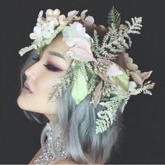 This Flower crown is amazing, it's perfect for a fairy costume. I love the pink flowers with the ferns. I can this being amazing at raves. #raves #flowercrown #ravehair Check out my board for more rave looks.                                                                                                                                                                                 More