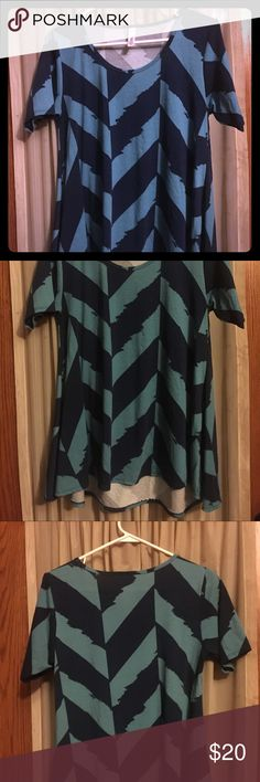 LuLaRoe small perfect Tee Made in USA, 96% Polyester and 4% Spandex, one of a kind pattern from LuLaRoe - size small LuLaRoe Tops Tunics