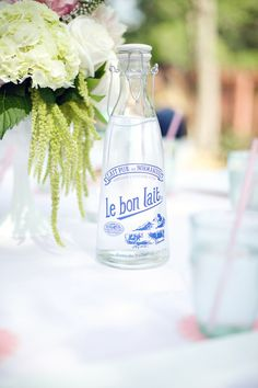Pretty bottle for water on the tables. My own bridal shower brunch. Photos by Connie Dai Photography. Flowers by Cori Cook Floral.