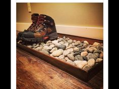 Buy a cheap wooden tray (stain it if you want), fill it with rocks, and use it to hold wet or dirty shoes by the door. Buy a cheap wooden tray (stain it if you want), fill it with rocks, and use it to hold wet or dirty shoes by the door. Men Apartment, First Apartment, Apartment Ideas For Men, Studio Apartment, Men's Apartment Decor, Bachelor Apartment Decor, College Apartment Decorations, Apartment Ideas College, Bachelor Pad Decor