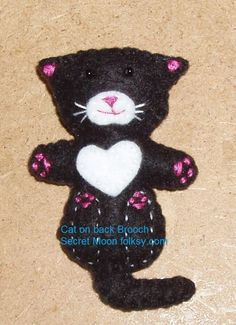 Cat on back Black Felt Brooch with white chest, muzzle £4.00