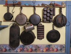 A long griddle like the one on the left bottom would be nice  (Griswold & Wagner Ware on Tobacco Lathe Pot Rack)