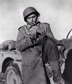 Photographer Robert Capa Pausing for a Smoke While on Duty at the Tunisian Front