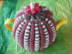 Traditional tea cosy worked in stripes.                                                                                                                                                                                 More