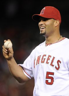 ANAHEIM, CA - APRIL 16: Albert Pujols #5 of the Los Angeles Angels reacts after tagging out Kurt Suzuki #8 of the Oakland Athletics during the seventh innning at Angel Stadium of Anaheim on April 16, 2012 in Anaheim, California. (Photo by Harry How/Getty Images)