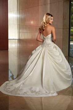 I wonder if I could alter my current gown to something similar to this...(Wedding gown by Karelina Sposa)