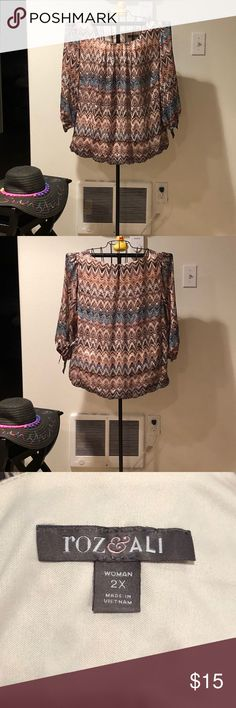Plus size tribal colored top w/ 3/4 sleeves Pretty pullover top w/ ties at sleeves & bottom. Is tribal colored & lined. Sleeves are sheer. Size 2X EUC Roz & Ali Tops Blouses