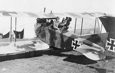 A German AEG C.IV reconnaissance aircraft with a cine-camera fitted in the gunner's position. Note the extra crew member to help with the camera, and the spare film magazine strapped on top. Palestine Front