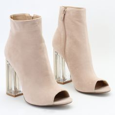 Give your boot collection a pop with Jenny. Featuring a contrasting perspex clear heel and a faux suede upper. The peeptoe detail gives these a glam feel and means you can dress the heel out of them. We'll be pairing ours with a longline skirt and jeans for day time wear and a sassy shirt dress for the evening, with all the accessories.  Heel Height: 4.1\
