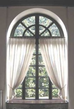 The combination of dark and light give a whimsical feel. Great dressing for a recessed palladian window. #curtains