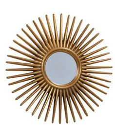 The Alaina is a vibrant, round mirror in gold with a sun-inspired design. This mirror has visual appeal and will create a lively atmosphere when added to its surroundings. This mirror can be hung anywhere in the home to add flair.