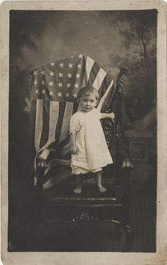 1918 Vintage Photo:  Barefoot little tot posed with an American flag.