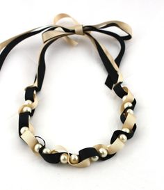 very cool concept. threading together ribbon and beads.