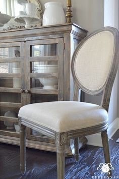 Neutral Breakfast Nook with World Market Linen Paige Round Back Dining Chairs