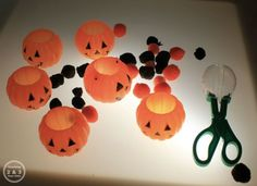 Color Activities on the Light Table: sorting into pumpkins using tongs and scoopers