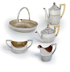 a_silver_tea_and_coffee-service_marked_faberge_with_the_imperial_warra_d5274547g.jpg (990×1024)