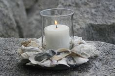 oyster shell candle holder. love! wonder if i could make this...