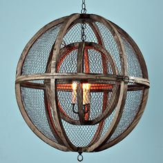 Double Sphere Wire Chandelier This unique country French chandelier is constructed of a small solid wood sphere frame nestled in a larger solid wood sphere frame, both spheres wrapped in a mesh wire. The distressed wood and wire combination bring the country French look together along with the bronze accents.