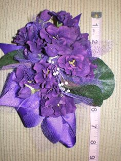 Very pretty, very LARGE African Violet corsage on eBay.