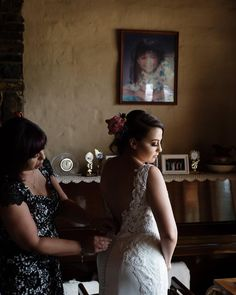 This is Brit and her mum, in her childhood home. Her parents built this beautiful rural property in Melbourne's outskirts themselves before Brit was born. Photographs of Brit and her brothers' childhood adorned the walls. Items of sentiment had been collected over the years. An entire families history surrounded me, and just for a day, I was a small part of it. #weddingphotoinspiration #weddinginspo #laceweddingdress #wedding #bridalportraits #junebugweddings #dirtybootsandmessyhair…