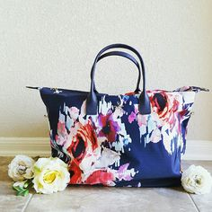 "Kate Spade Classic Nylon Lyla Weekender Floral Bundle and save! 15% off TODAY ONLY! Perfect for travel! Absolutely gorgeous (and practical!), NWT Kate Spade Classic Nylon Weekender in ""Hazy Floral,"" a beautiful navy blue with red and purple florals. Large and roomy, this piece is approx. 15.5"" in length and 9"" wide, w/ 7.5'' drop and 10'' - 22'' adjustable, detachable strap. Durable nylon with leather trim, 14K gold- plated hardware, interior slip pockets and zippered top closure. kate spade…"