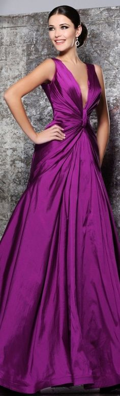 We love this haute couture formal ball gown in this magnificent magenta purple color. The deep v neck and gather into the center bodice make the design.  We can create something like this dress for you in any color, size or with any changes. Custom evening gown designs & replicas of haute couture evening dresses are our specialty. www.dariuscordell.com