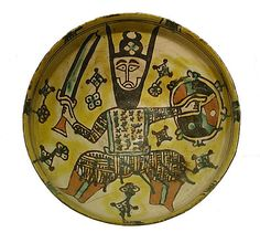 Bowl with a Man Holding a Sword and Shield, 10th century. Iran, Nishapur. The Metropolitan Museum of Art, New York. Louis V. Bell Fund, 1966 (66.176) #sword