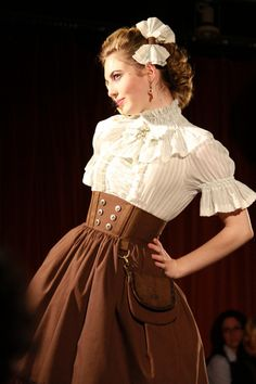 Steampunk:  I love the sweet simplicity of this one.  And the little purse attached to the skirt. Totally girly and fresh.