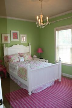 Girls room with Lilly Pulitzer bedding, pottery barn teen pink rug and mini chandelier. Design by Evans Home Building.