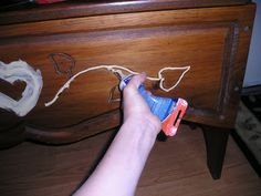 How to resurface a furniture piece with wood carvings on it before painting.