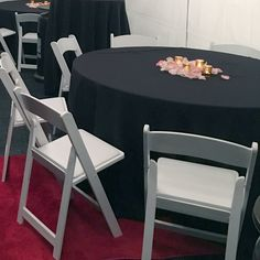 "60"" Round tables, round black tablecloths, white padded folding chairs and red carpets for rent in Los Angeles, CA #PartyRentals #LosAngeles #PartyRentalsLosAngeles #KidsPartyRentals - http://www.bigblueskyparty.com/table--chair-rentals.html"