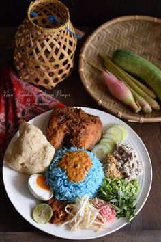 Nasi kerabu is a Malay rice dish, a type of nasi ulam, in which blue-coloured rice is eaten with dried fish or fried chicken, crackers, pickles and other salads.