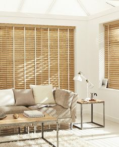 Wood Venetian blinds in a conservatory look great! Don't forget though to add simple touches to your accessories and furniture to bring your colour scheme together.