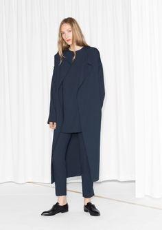Double layered front Open coat Model wears: EU 36/ UK 10/ US 6      Length of coat: 118.5 cm (size 36)