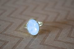 Oval Moonstone Ring Our Oval Moonstone Ring is a La Lune essential. Made up of Brilliant Genuine Swarovski crystal, and are set in adjustable gold plated ring. It's simple and fun and will add a lot of Sparkle to any look. — Boutique La Lune