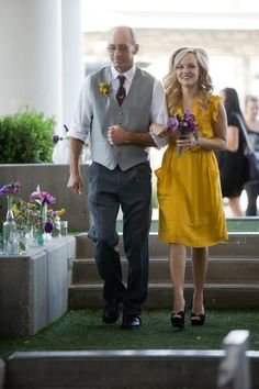 yellow dress and the men in vests and grey