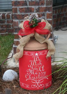 dress'n up the old milk can. Used doormat from the $Tree, punched couple of holes on sides and tied around can. Then simple bow using burlap and some leftover mesh ribbon. Top with white snow spray pained pine cones. Change for every season for under $5 !!!