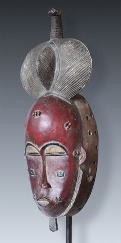A red painted Dance-Mask mblo,       Baule-Peoples, Ivory Coast