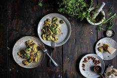 orecchiette with spring herb pesto & sausage   two red bowls