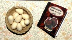 This was for a Turkey Anything swap on Hittygirls.  On the right, I made the teeny basket and filled it with polymer clay *turkey* eggs.  On the left is a Thanksgiving Activity Book for Hitty that really opens, and has coloring pages, puzzles, Thanksgiving facts, riddles, and more.  I made that too--and it's *about* 1:12 scale.
