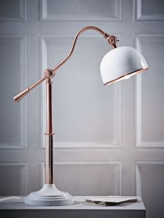 Made from brass with a powder coated white shade and base, our Elegant Desk Lamp has an adjustable, angled arm and head. The mid section and shade rim have a metallic copper finish, lending a touch of quirky style to your home office, beside ta Luxury Lighting, Cool Lighting, Modern Lighting, Lighting Design, Kitchen Light Fittings, Pendant Light Fixtures, Tall Lamps, Guest Room Office, Contemporary Table Lamps