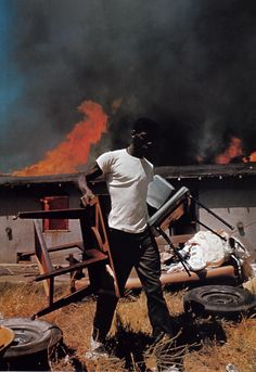 Co Rentmeester - A man salvaging his furniture as his house burns down during the Watts rooting, Los Angeles, 1965 Civil Rights Movement, African Diaspora, African American History, Life Magazine, Photojournalism, Black People, Black History, The Neighbourhood, War