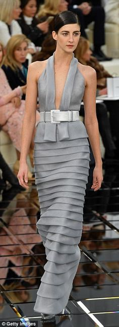 Cinched in: The colletion's silhouette, inspired by the shape of a spoon, sees garments clinched in around a raised waist to showcase models' rib cages using a thick buckled belt