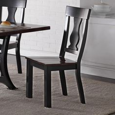 This two-toned wooden side chair features a classic design with subtle details adding style and character. The chair features details such as a shaped back with a turned vase design, square black legs and a saddle seat. The seat of chair has a lighter finished the base and backrest, allowing it pair well with the trestle table from this collection.