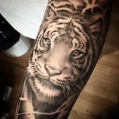 Realistic Tiger tattoo in Black and grey by our latest guest artist Vinnie!