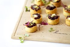 4 cups thinly sliced onions 2 tablespoons butter 1/4 cup packed brown sugar 1 tablespoon balsamic vinegar 2 garlic cloves, minced 1/4 teaspoon salt Dash pepper 2 packages (1.9 ounces each) frozen miniature phyllo tart shells 1 round (8 ounces) Brie cheese, cut into 30 pieces